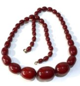 Antique cherry amber / bakelite bead necklace largest bead measures approx 3.2cm by 2.3cm weight 71g