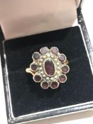 Antique Georgian 22ct gold garnet and seed-pearl ring in good condition weight 6.6g