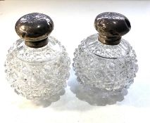 Pair of antique silver top perfume bottles the silver tops are in need of restoration dents and