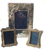 3 silver picture frames largest measures approx 24cm by 18cm