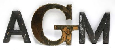 A brass letter 'G' and a quantity of wooden letters