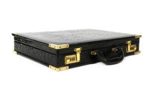 A crocodile leather briefcase,