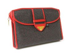 A vintage Yves Saint Laurent brown and red coated canvas clutch