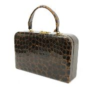 A vintage crocodile leather vanity case by Maylor, London,