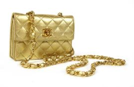 A Chanel gold mini flap bag