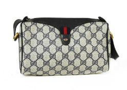 A Gucci Accessory Collection beige coated canvas and blue leather zip shoulder bag