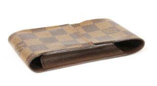 A Louis Vuitton Damier Ebène cigarette case