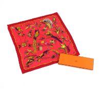 An Hermès silk scarf,