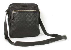A Gucci black leather crossbody messenger bag