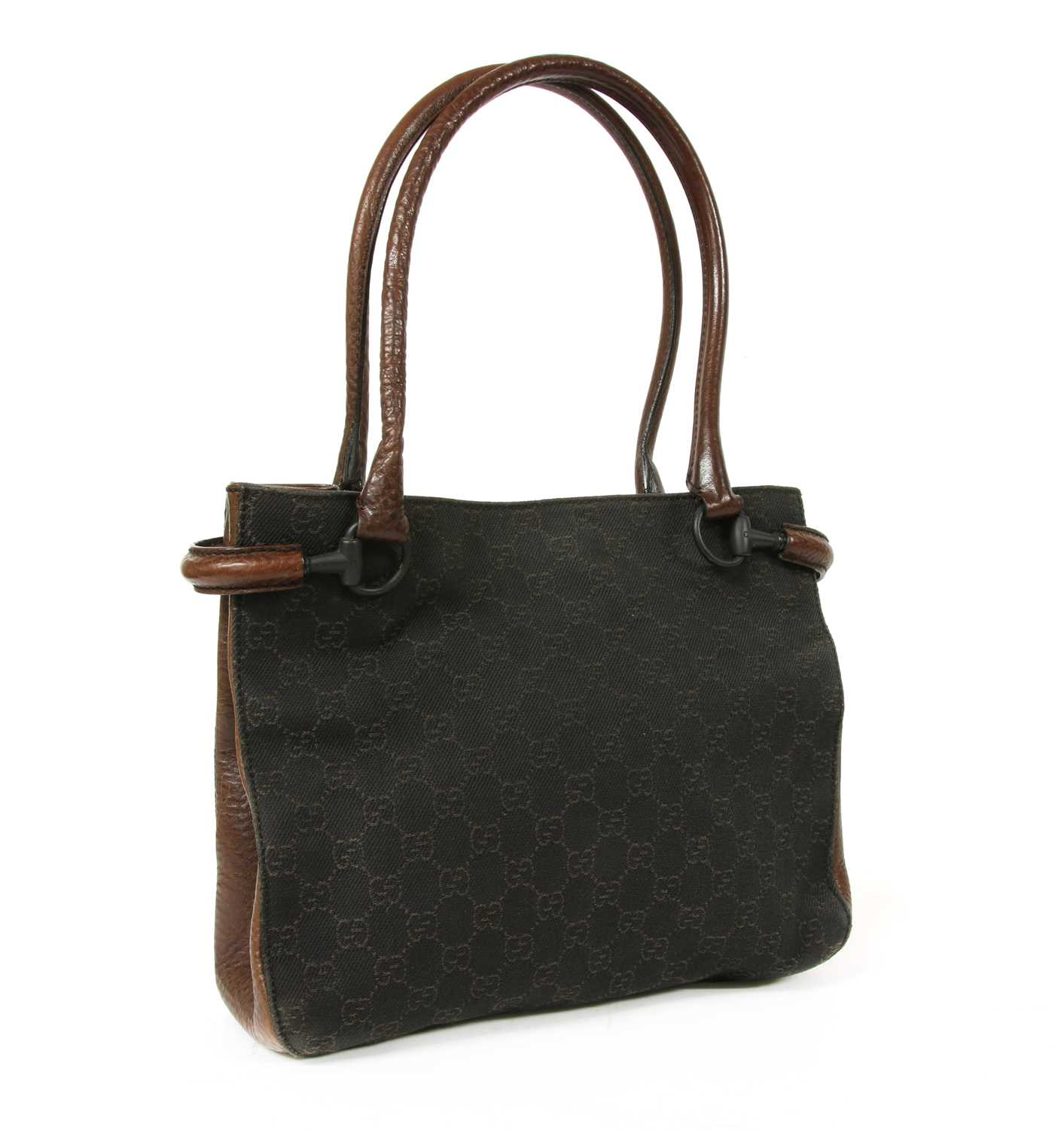 A Gucci dark brown canvas curved handle bag