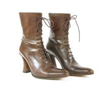 A pair of Michel Perry brown leather ankle boots