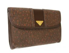 An Yves Saint Laurent brown coated canvas clutch bag,