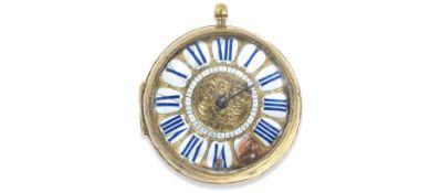 A large key wind open face oignon pocket watch