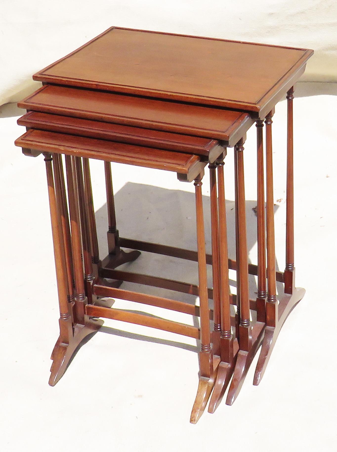 Lot 30 - Quartetto nest of four 19th Century mahogany coffee tables