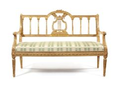 Late 19th century carved giltwood settee in the Louis XVI style