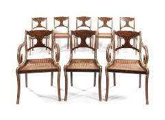 A set of six Regency faux rosewood dining chairs with a matching pair of later open armchairs