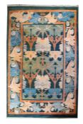 A contemporary Arts and Crafts design carpet after a design by C. A Voysey