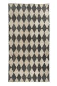 A contemporary diamond motif suede rug
