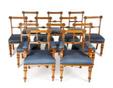 A set of twelve Victorian Gothic Revival carved oak dining chairs incl. a pair of open armchairs