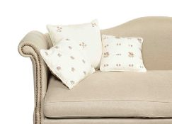 Three new Chelsea Textiles dusty pink and white hand embroidered floral sprig cushions