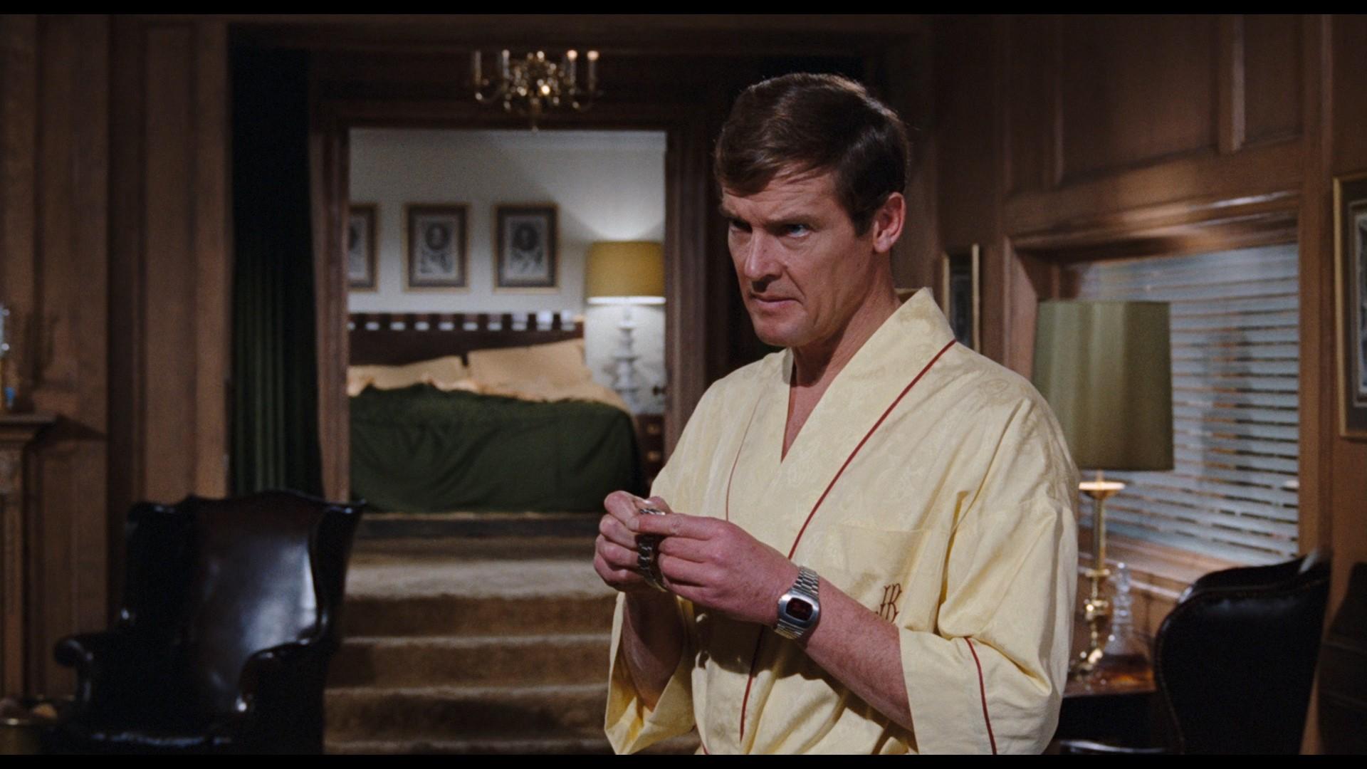JAMES BOND: LIVE AND LET DIE (1973) - James Bond's (Roger Moore) Hamilton Pulsar Watch, On-set Photo - Image 12 of 13