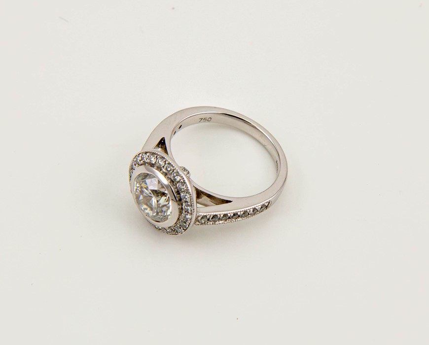 Lot 55 - An 18ct white gold diamond ring, the central diamonds 2.01ct, HS12, diamonds to the shoulders and