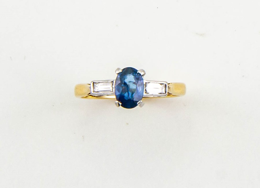 Lot 14 - An 18ct gold, sapphire and diamond set ring, the sapphire approx 0.90ct, with baguette cut