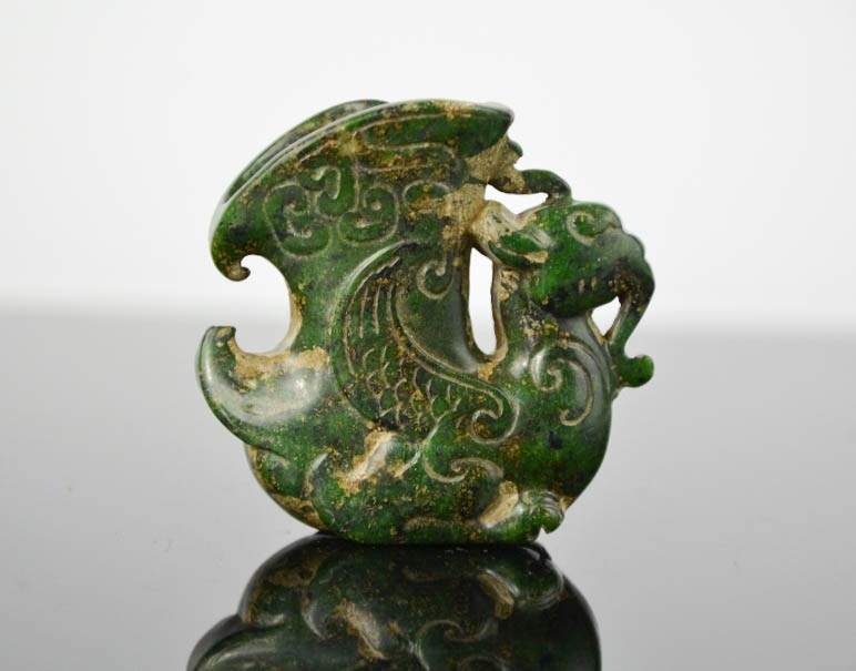 Lot 281 - A Chinese natural jade handcarved small ceremonial dragon cup statue. 5cm by 5,5cm