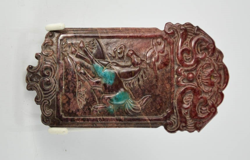 Lot 250 - A Chinese natural jade hand carved plaque depicting a horse. 10cm x 5cm