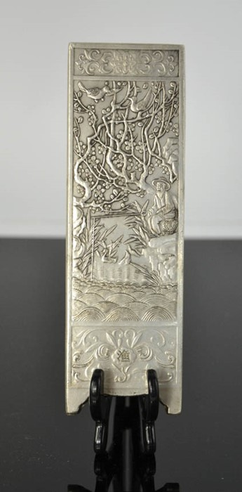 Lot 287 - A Tibetan Miao silver scroll weight, signed and stamped, of a fisherman 179g.15cm by 5cm