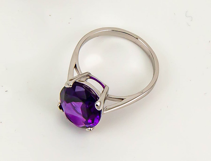 Lot 11A - A 9ct white gold oval amethyst solitaire cocktail ring, approximately 4.5ct, size N, 3.4g.