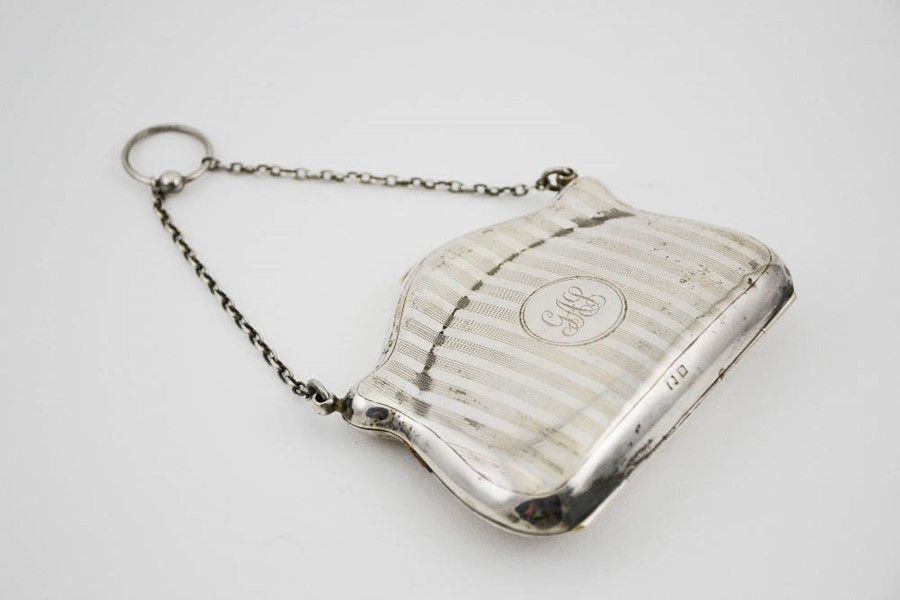 Lot 178 - A silver purse, with machine engraved decoration and monogram to the centre, Birmingham 1911,