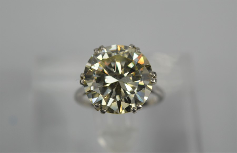Lot 54 - A platinum diamond solitaire ring, the brilliant cut 9.35ct diamond in a six double claw setting,