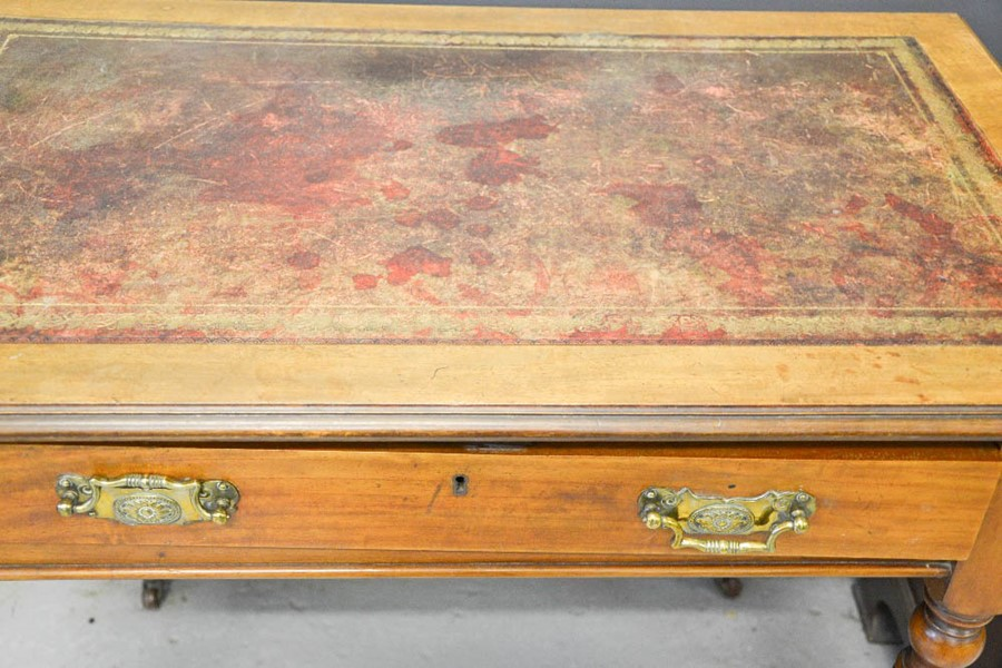 Lot 364 - A 19th century mahogany desk with red leather top, and single drawer with brass handles, raised on