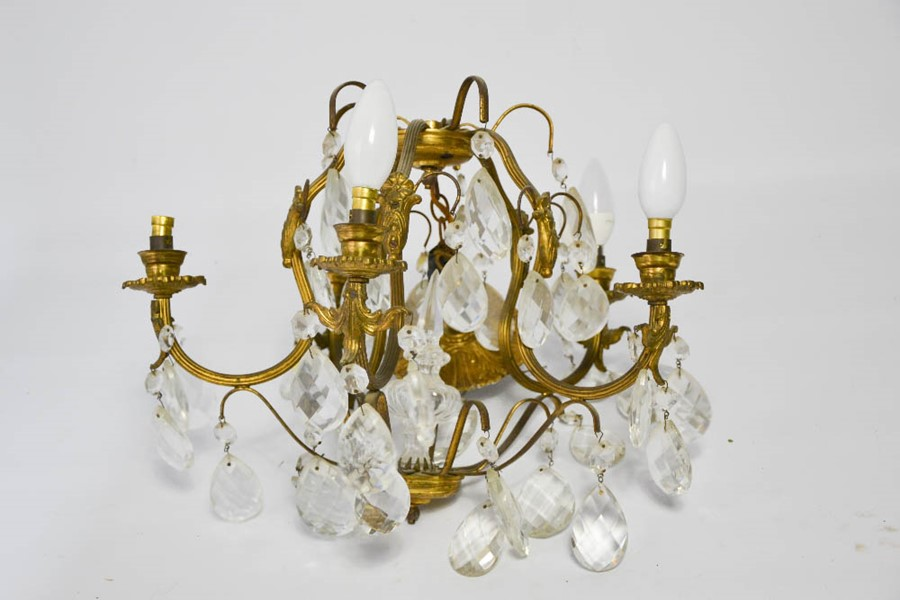Lot 358 - A gild brass French 1930s chandelier, with faceted drops and five branches, 43cm wide.