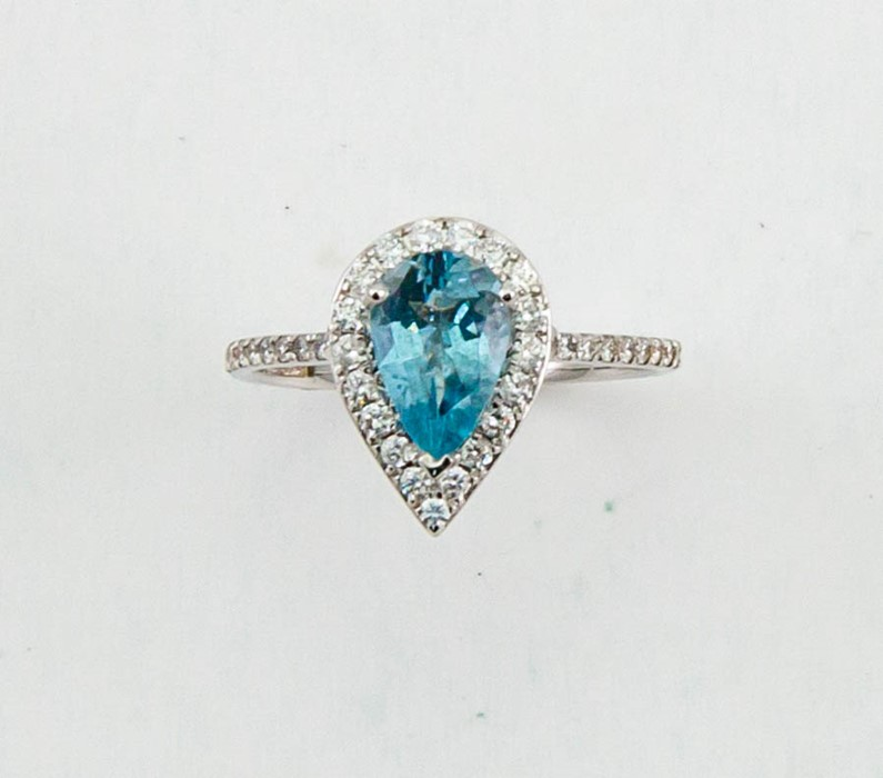Lot 8 - An 18ct white gold, diamond and aquamarine ring, the pear cut aquamarine approx 1ct, bordered by