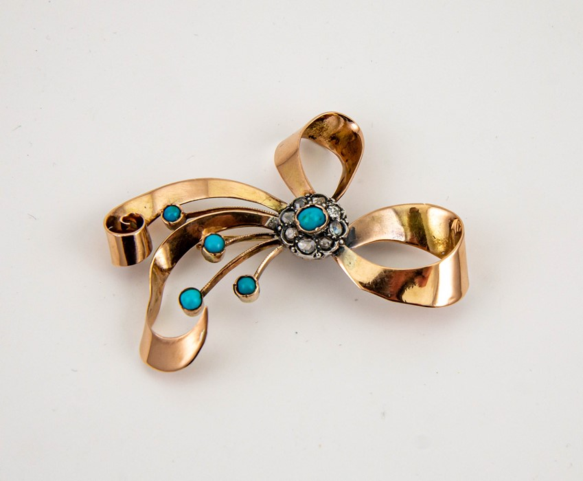 Lot 9 - A large yellow metal (tested as 9ct) 1930s diamond and turquoise brooch, in the form of a bow, 6½