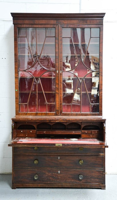 Lot 369 - A Georgian mahogany secretaire bookcase, with two upper astrigal glazed doors enclosing height