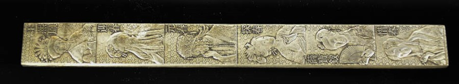 Lot 265 - A Tibetan Miao silver stamped scroll weight depicting six ladies 148g.