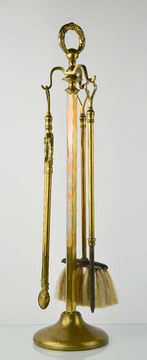 Lot 344 - A brass fireside companion set.