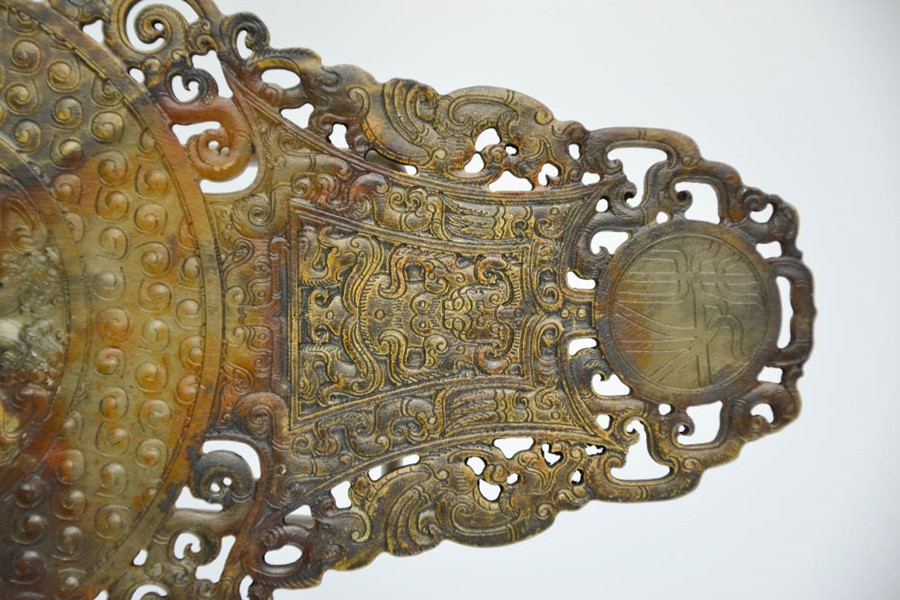 Lot 271 - A Chinese hand carved natural heitian jade plaque decorated with pierced work dragons 22cm high.