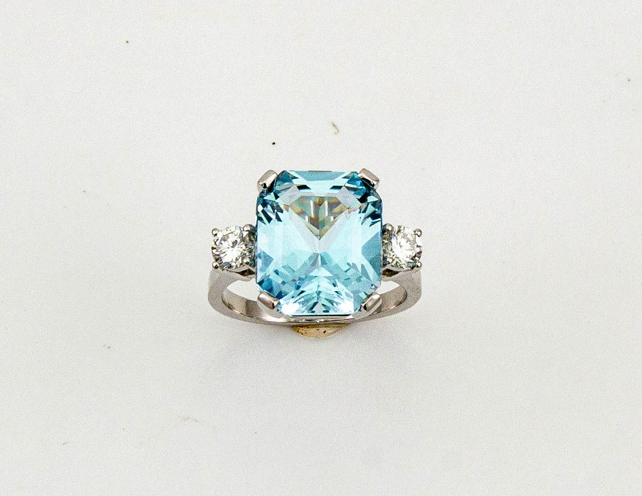 Lot 51 - A platinum, aquamarine and diamond ring, the emerald cut aquamarine 7.42ct, flanked by two