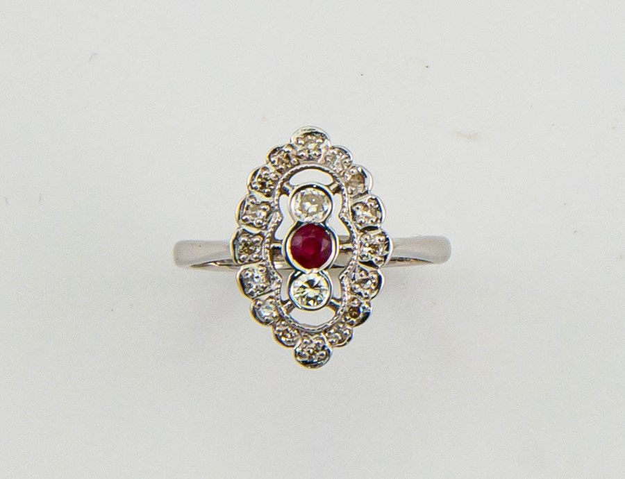 Lot 13 - An 18ct white gold Art Deco style diamond and ruby ring, size N½, 3.8g.