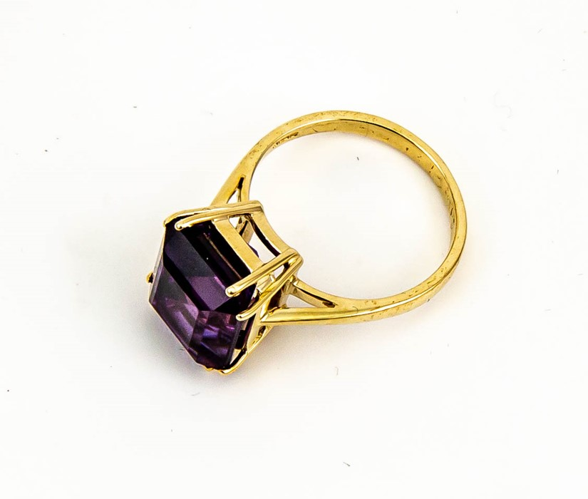 Lot 7 - A 9ct gold and amethyst solitaire cocktail ring, the emerald cut amethyst, approx 6cts, size O, 4.