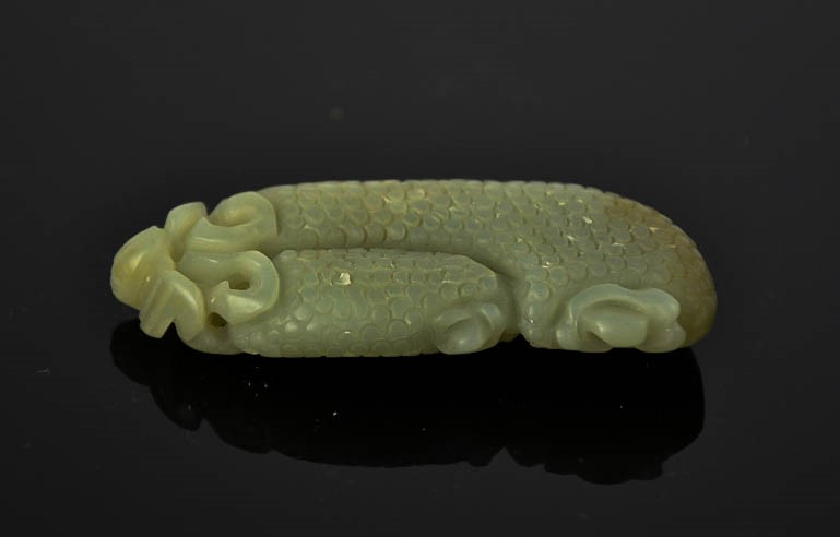 Lot 278 - A Chinese natural heitian green jade hand carved pendant. 6cm by 6.5cm