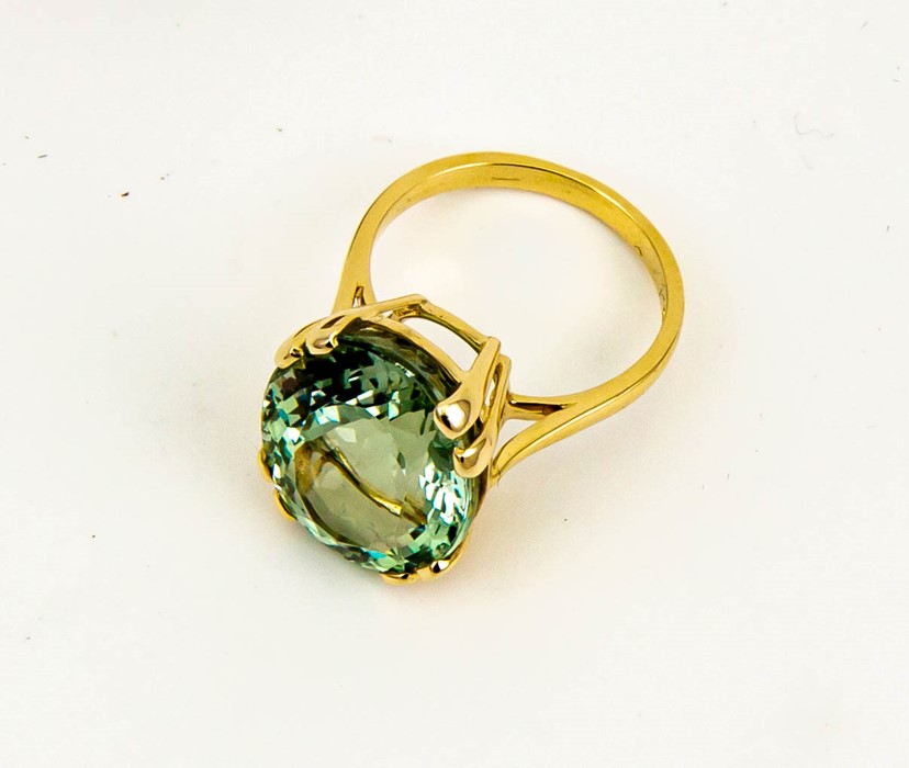 Lot 5 - A 9ct yellow gold and green prasiolite solitaire, of oval form approx 14ct, size N, 5.8g.