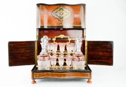A fine 19th century French burr walnut, ebony and boule work decanter and glasses box, inlaid with