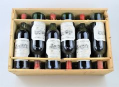 A case of twelve Gallaire & Fils - Chateau d'Angludet - Margaux 1981 bottles of red wine