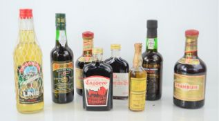 A group of liqueurs, port and wine to include Drambuie, Cockburn's port , Doliveira madeira wine and
