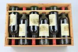 A case of twelve bottles of 1981 Chateau Magdelaine - Saint Emilion grand cru classe red wine
